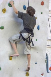 A boy doing a wall climb