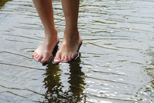 Feet standing in water