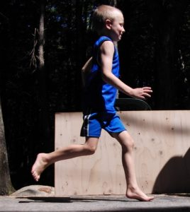 Boy demonstrating barefoot running.