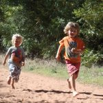 Boys running on dirt